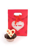 Red bag for gifts with muffin Stock Images