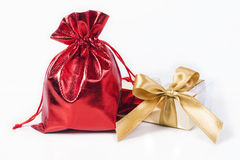 Red bag  and  gold bow Royalty Free Stock Photography