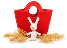 Red bag and knitted hare Stock Photography