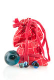 Red bag with marbles Stock Photography