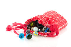 Red bag with marbles Royalty Free Stock Photography