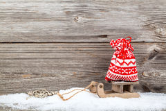 Red bag on old rustic wooden sledge Royalty Free Stock Photo