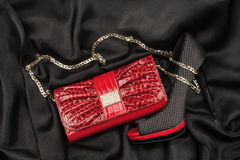 Red bag and shoes  lying on black  fabric Royalty Free Stock Image