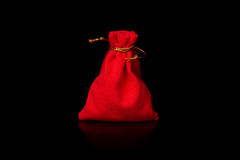 Red bag. Red velvet pouch to hold jewelry and delicate items  on black background. The file includes a clipping path, so it`s easy to work Royalty Free Stock Photo