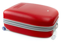 Red baggage. Red solid baggage with handle Stock Photography