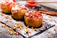 Red Baked Apples Stuffed Cottage Cheese And Granola stock image