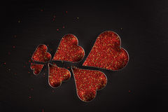 Red baking topping in heart shaped cookies molds Royalty Free Stock Photo