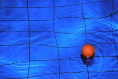 Red ball. A red ball in swimming pool Royalty Free Stock Image