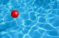 Red ball and blue water Stock Photo