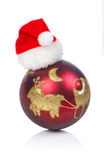 Red ball with Christma hat Royalty Free Stock Image