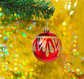 Red ball on christmas. Light background Royalty Free Stock Image