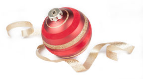 Red ball Christmas ornament, gold ribbon on white Royalty Free Stock Photography