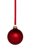 Red Ball Christmas Ornament. Red Christmas ball ornament hanging on red ribbon Stock Images