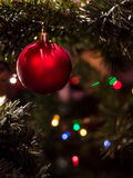 Red ball - Christmas tree decoration with garland Royalty Free Stock Image