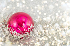 Red ball and Christmas wreathn a tinsel backrgound Royalty Free Stock Image