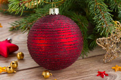 Red ball decoration and fir tree Stock Photography