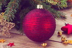 Red ball decoration and fir tree. Red  christmas ball  decoration with   fir tree, retro toned Stock Photo