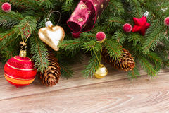 Red ball decoration and fir tree. Glass ball with retro christmas  decoration  and fresh fir tree Stock Photography