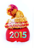 Red ball with 2015 digits in cap in the snow Royalty Free Stock Photos