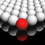 Red ball in front. Lots of golf balls, red ball in front Stock Image