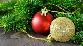 Red ball Golden ball, Christmas toy, Christmas tree branch on a. Wooden background Stock Photography