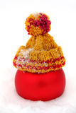 Red Ball in Knitted Cap in the Snow Royalty Free Stock Image