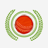 Red ball with laurel wreath for Cricket. Stock Image
