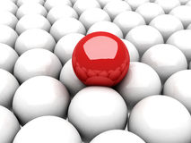 Red ball leader on many white balls Royalty Free Stock Photo