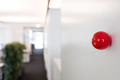 Red ball with magnet at a wall. In a moulder office Royalty Free Stock Image