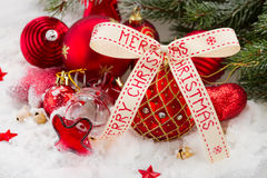 Red  ball with merry christmas ribbon Royalty Free Stock Images