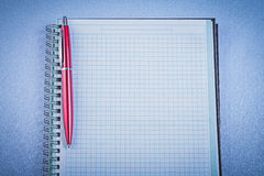 Red ball-point pen checked notepad office concept Stock Photos