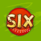Red ball with text for Cricket. Red ball with creative text Six for shot in Cricket match on stylish green background Royalty Free Stock Photo