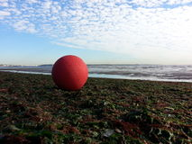 Red ball under blue skies. Stock Image