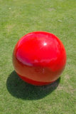 The red ball view. The red ball on the green grass view royalty free stock photos