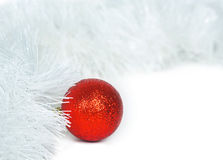 Red  ball and white Christmas tinsel Stock Photos