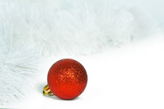 Red  ball and white Christmas tinsel Royalty Free Stock Photography