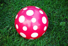 Red ball with white dots. Red ball with white polka dots stock photo