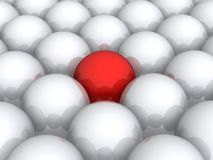 Red ball within white ones Stock Image