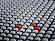 Red ball among white spheres Royalty Free Stock Photos