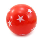 Red ball with white stars on it Stock Photos
