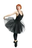 Red ballerina wearing black tutu Stock Images