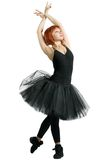 Red ballerina wearing black tutu Royalty Free Stock Image