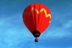 Red Ballon. Hot Air Ballon floating through Minnesota skies stock photo