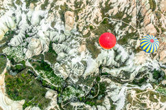 Red ballon and ballon with yellow and blue stripes above Cappadocia, Turkey stock image