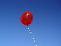 Red balloon. Red heart on blue sky (see my portfolio Royalty Free Stock Photo