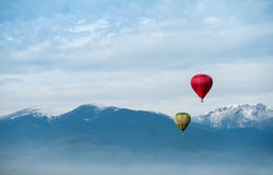 Red balloon in the blue sky. Red balloon in the blue cloudy sky Stock Image