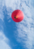 Red balloon in the blue sky Stock Photos
