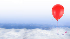Red balloon on blue sky with white clouds Stock Photo