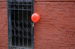 Red balloon at the entrance Royalty Free Stock Photo