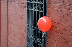 Red balloon at the entrance Stock Photo